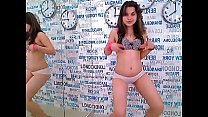 LittleTeenBB Riley strips down to bra and panties, then takes off bra.
