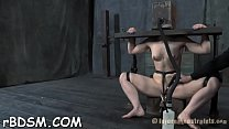 Caged up chicks are forced to pleasured each other