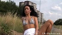 Outdoor masturbation and daring public pussy flashing of sexy amateur brunette S image