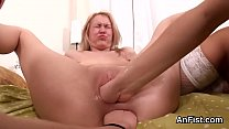 Horny lesbo honeys are stretching and fisting assholes
