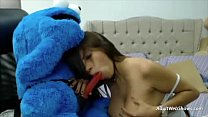 Pregnant ebony plays with Cookie Monster - AdultWebShows.com image
