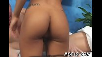 Lusty beauty gets drilled on a massage table en...