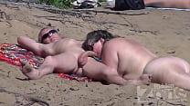 Blowjob on a nudist beach thumbnail