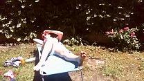 12726 La tua mamma porca in giardino prende il sole con il suo grosso diaper pieno di piscia preview