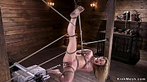 Babe in bdsm suspension fucks machine