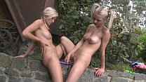 Teen lesbians with a double dong dildo outdoors