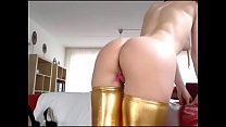 Sexy girl teases pussy plug with golden stockings