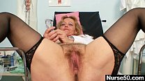 Filthy mature lady toys her hairy pussy with speculum thumbnail