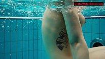 Tattooed baby swirls underwater Image