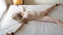 Busty Teen Scarlet struggles to free herself after being tied down to the bed.