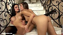 Beautiful vixens Peaches and Aletta go down on each other on the stairs