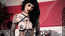 Busty Goth Babe Jessie Lee is a tattooed beauty...