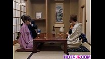 Japanese milfs sticks cock in her cunt next to other couple thumbnail