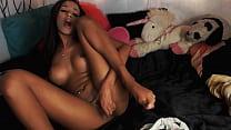 Petite brunette stripteasing & fingers her tigh...