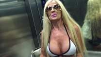 Big Boob Milf plays with her Pussy on Public po...