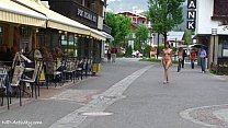Teen shows her nude body on a public street preview image