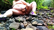 Fat Hippie redhead masturbating by a creek nake...