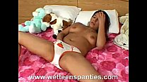 Girl rubs her slit with her panties