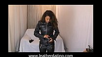 Ebony chick showing of an entire leather outfit