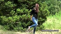 Skinny teen pissing behind a wall outdoor video