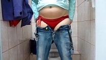 Pissing in the public toilet and undressing in the dressing room at the mall. Image