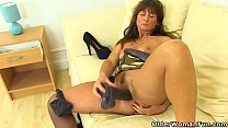 English milf Lelani gets busy with two giant dildos preview image