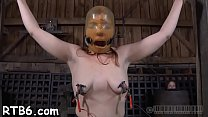Tied up villein receives taut mask with hard toy in her cunt