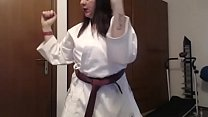 Young karate girl sweats and trains you by showing her hot sweaty body