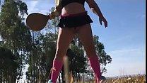 Wife playing racquet wearing thong