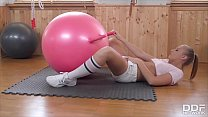 Gym enthusiast Milana Blanc can't wait to ride sex toy rubber ball's dong thumbnail