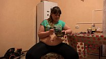 A beautiful bbw in leggings and with a big belly eats and shakes a thick stomach. Home fetish. thumbnail
