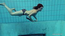 15435 Redheaded Katrin is stripping underwater preview