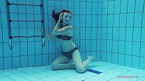 19696 Redheaded Katrin is stripping underwater preview