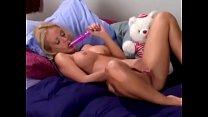 Blonde chick Jana Cova masturbating with pink dildo on bed