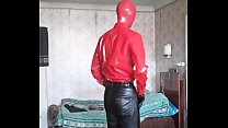 In leather pants and red PVC shirt