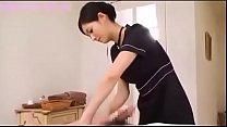 Japanese brunette performs massage and handjob Image
