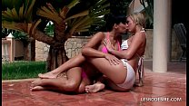 Stunning lesbian teens strip off their wet bikini tops
