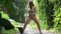 Pee Standing - Curvy brunette relieves herself ... Thumbnail