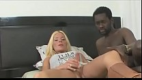 Very sexy blond shemale rides a black cock