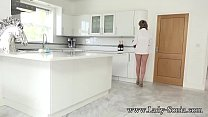 Lady Sonia masturbating on the kitchen counter preview image