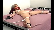 Breasty chick gets totally restrained and ball-gagged