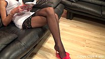 Tall woman stockinged long legs and extreme high heels dangling