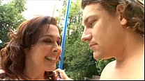 Brunette MILF sucks her poolboys cock by the pool preview image