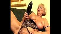 Granny Elizabeth masturbating on sofa