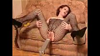 Redhead slut in fishnet masturbates with dildo ...