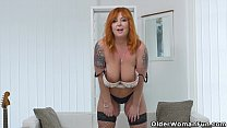 Redhead milf Alex strips off and fingers her ma...