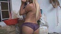 A sexy shemale in purple underwear masturbates