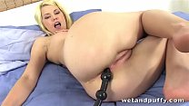 Delphine sticks a long tube up her ass