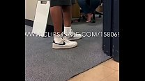 Librarian Barefoot in Her Office
