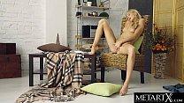 Stunning blonde masturbates as she watches porn